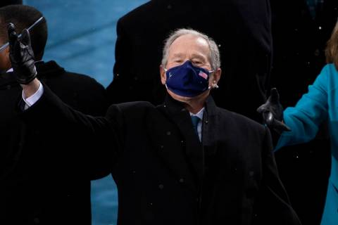 Former President George W. Bush arrives at the 59th Presidential Inauguration at the U.S. Capit ...