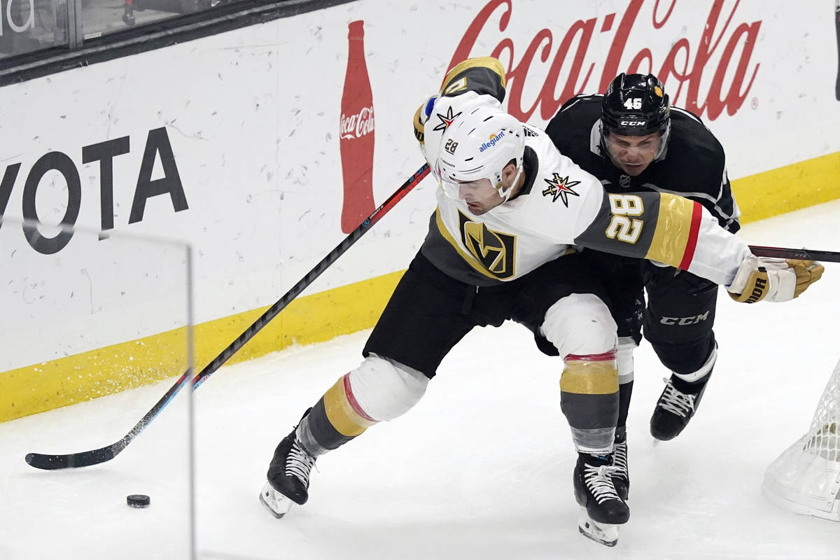 Vegas Golden Knights left wing William Carrier (28) controls the puck in front of Los Angeles K ...