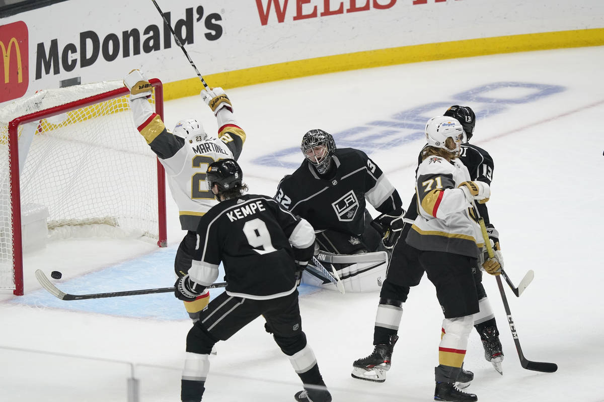 Los Angeles Kings goaltender Jonathan Quick, center, gives up a goal to Vegas Golden Knights ce ...