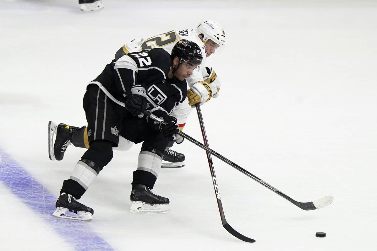 Los Angeles Kings center Andreas Athanasiou (22) works against Vegas Golden Knights left wing T ...