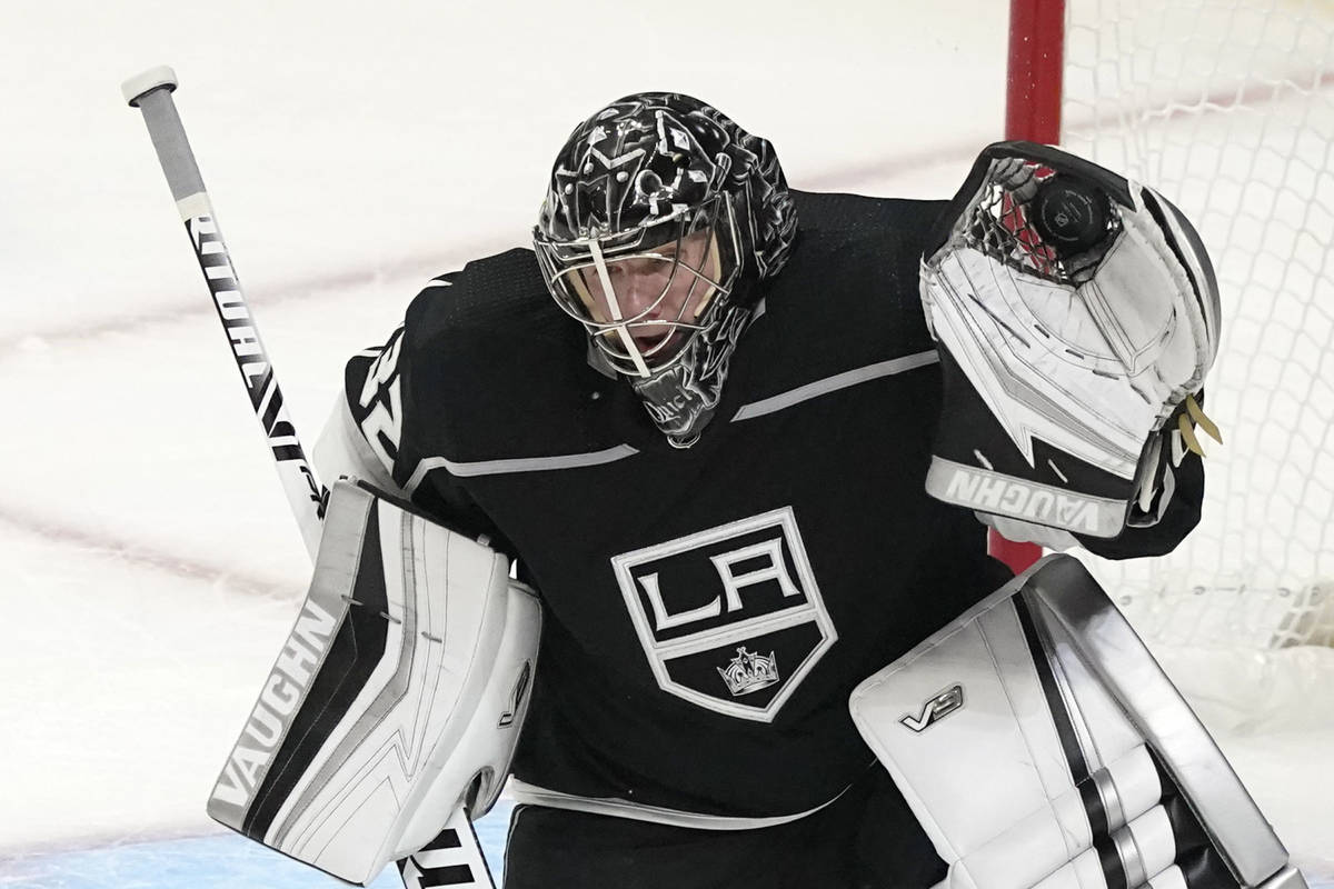 Los Angeles Kings goaltender Jonathan Quick stops a shot during the first period of the team's ...