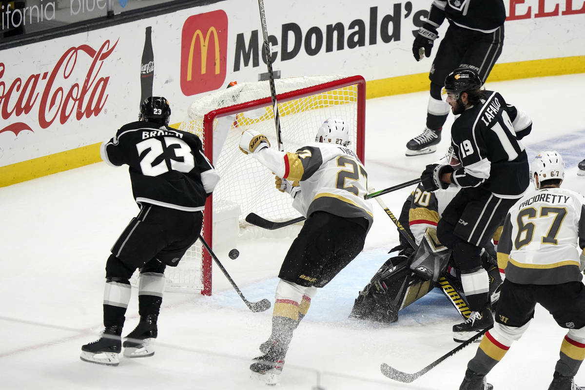 Los Angeles Kings left wing Alex Iafallo, right, scores during the first period of the team's N ...