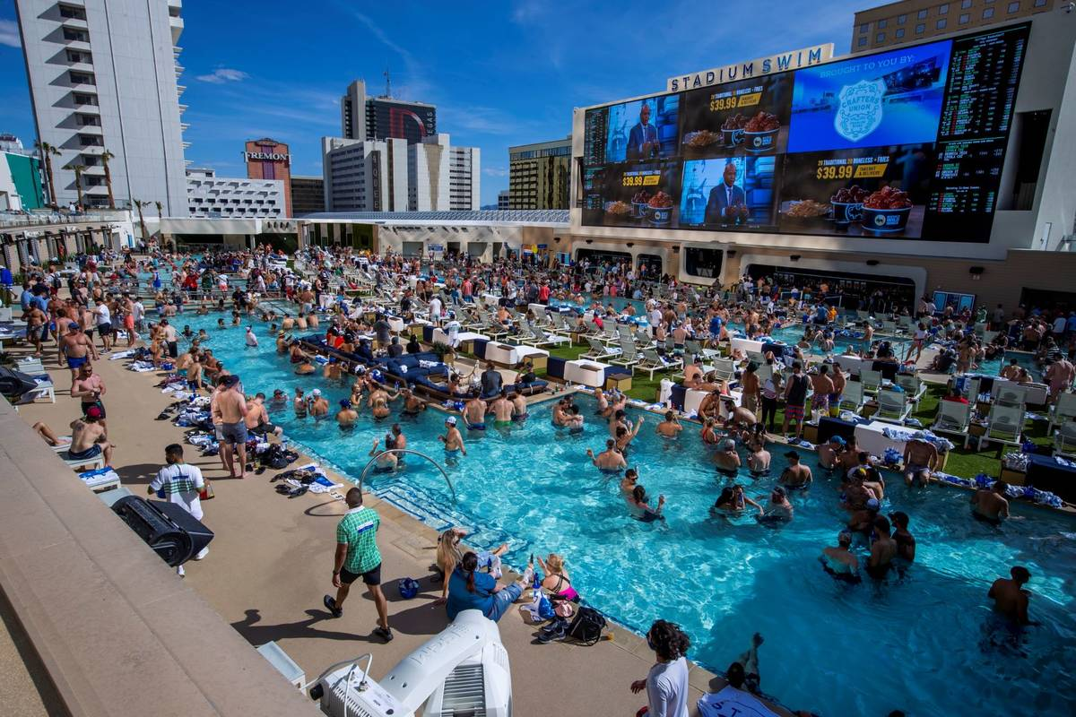 The pools and decks are crowded in Stadium Swim at the ...