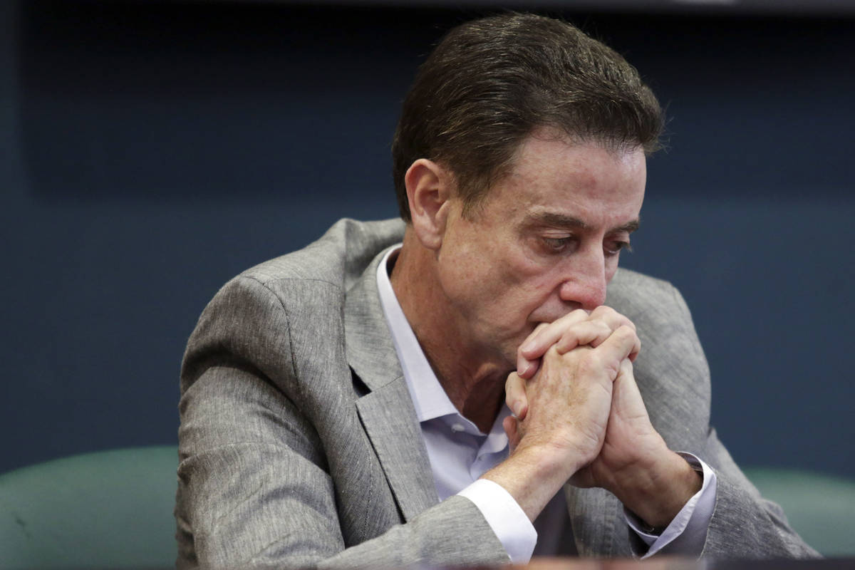 FILE - In this June 15, 2017, file photo, Louisville basketball coach Rick Pitino listens durin ...