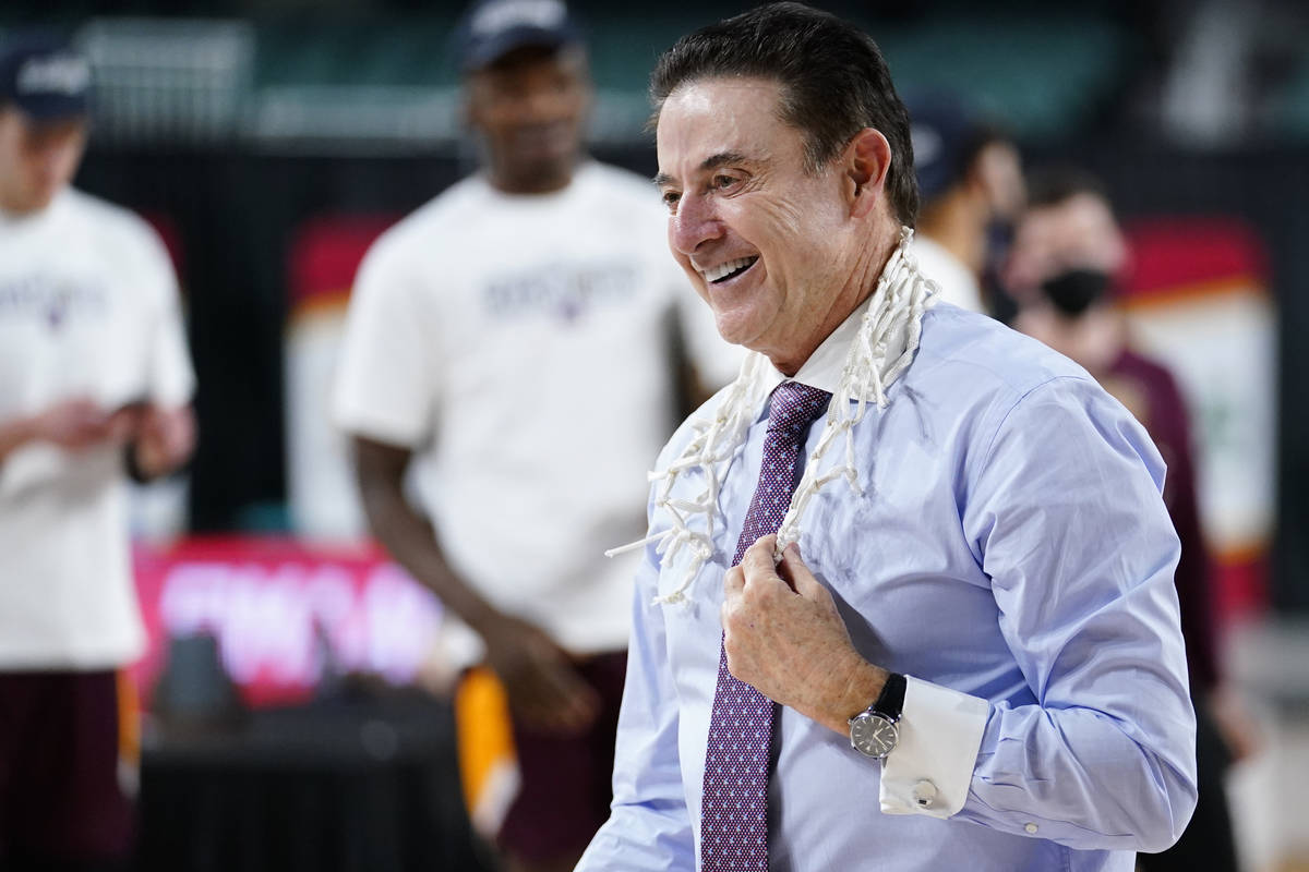 FILE - Iona head coach Rick Pitino celebrates after Iona won an NCAA college basketball game ag ...