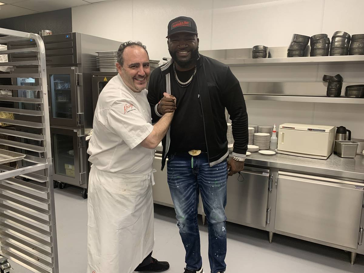 """Chef Barry Dakake and David """"Big Papi"""" Ortiz are shown at Circa on Thursday, March 18, 2021. (C ..."""