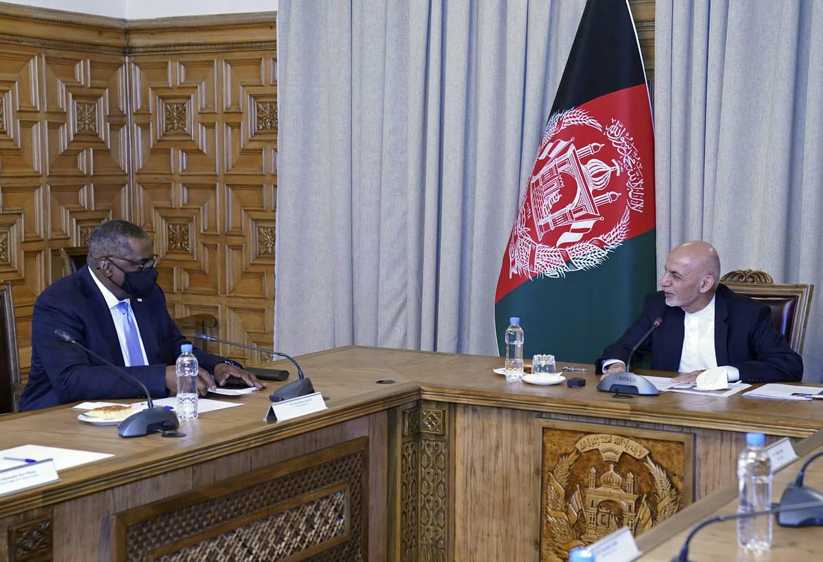 U.S. Defense Secretary Lloyd Austin, left, meets Afgan President Ashraf Ghani at the presidenti ...