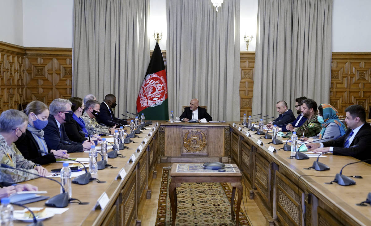 Afgan President Ashraf Ghani, center, meets with U.S. Defense Secretary Lloyd Austin, center le ...