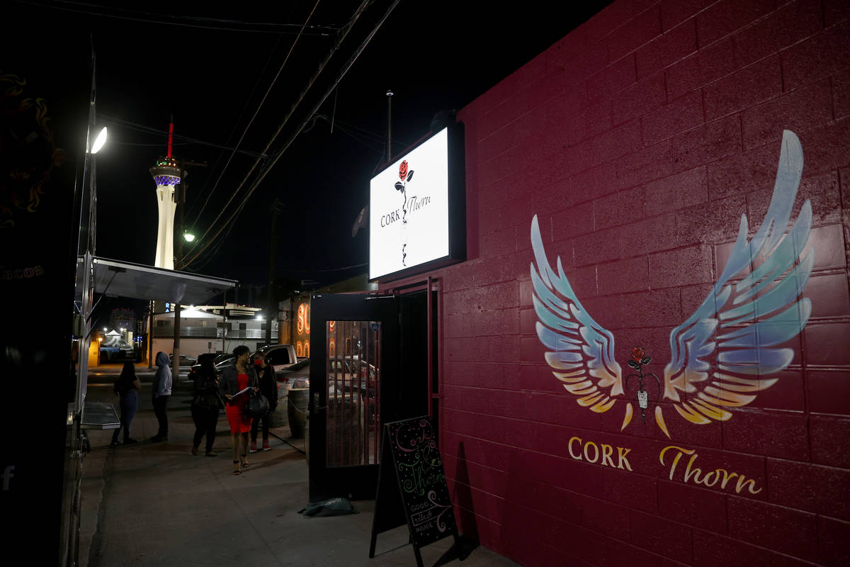 People arrive on reopening night at Cork and Thorn in downtown Las Vegas Sunday, March 21, 2021 ...