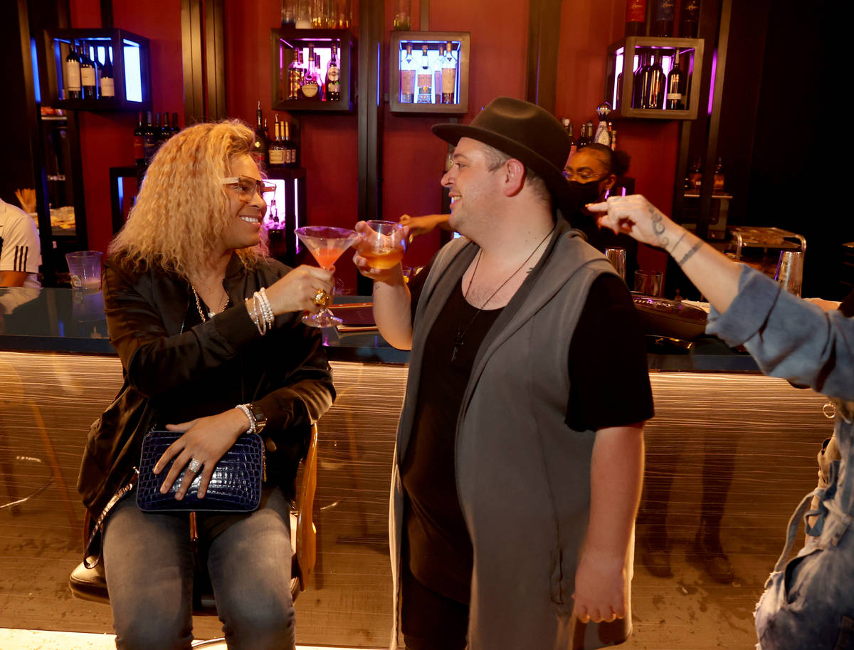 Ricky Tucker, left, and Jon Morgan on reopening night at Cork and Thorn in downtown Las Vegas S ...