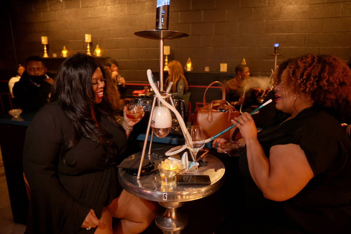 Capucine Holmes, left, and Asha Joneson on reopening night at Cork and Thorn in downtown Las Ve ...