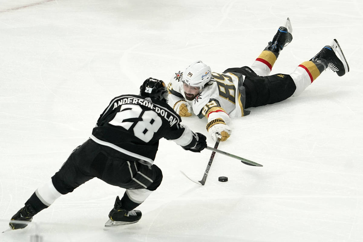 Los Angeles Kings center Jaret Anderson-Dolan, left, and Vegas Golden Knights right wing Alex T ...
