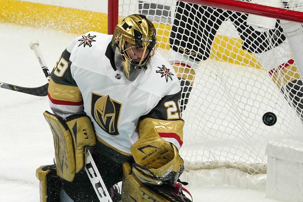 Vegas Golden Knights goaltender Marc-Andre Fleury deflects a shot during the second period of a ...