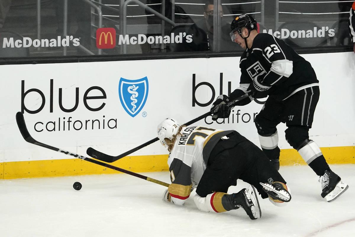 Vegas Golden Knights center William Karlsson, left, falls while under pressure from Los Angeles ...