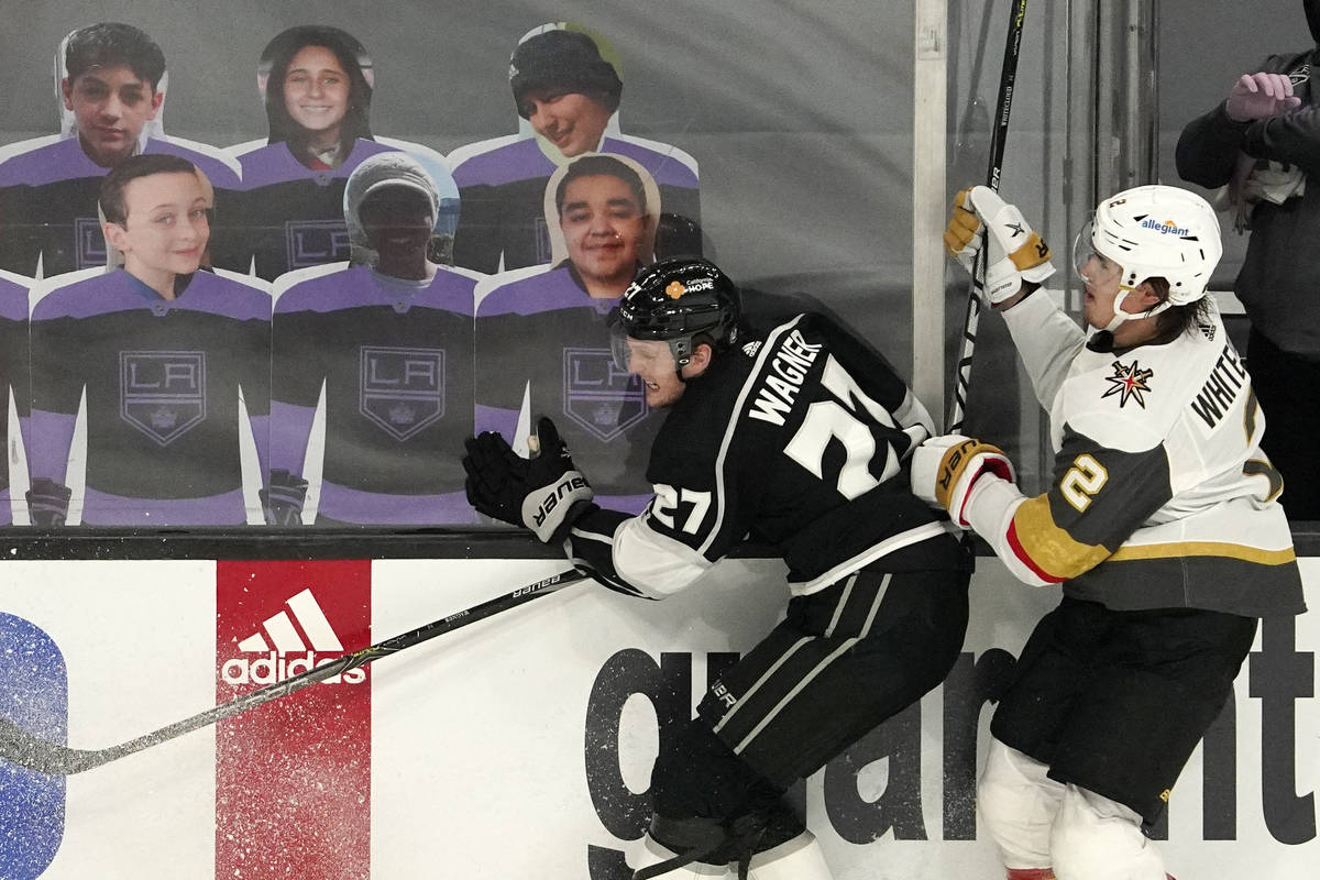 Los Angeles Kings left wing Austin Wagner, left, and Vegas Golden Knights defenseman Zach White ...
