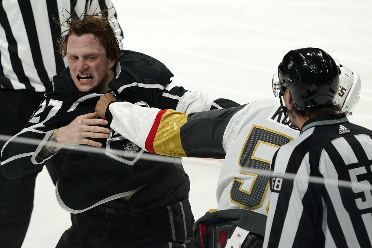 Los Angeles Kings left wing Austin Wagner, left, and Vegas Golden Knights right wing Keegan Kol ...