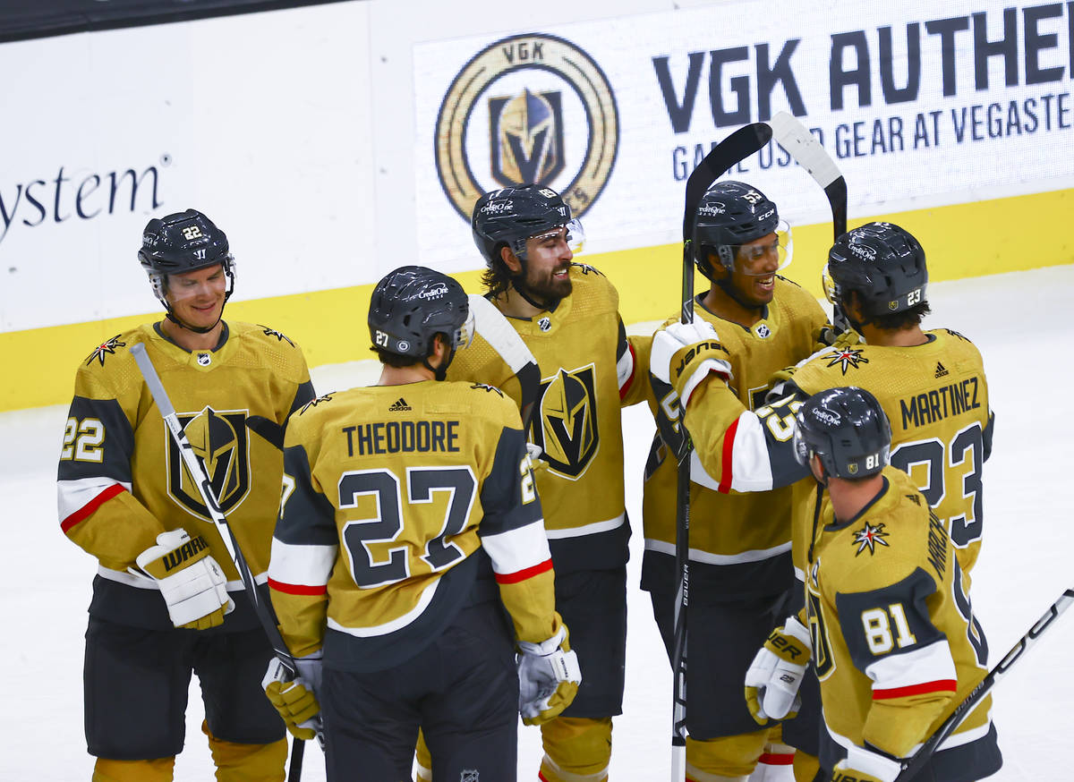 Golden Knights' Keegan Kolesar, center right, celebrates with teammates after a hockey game whe ...