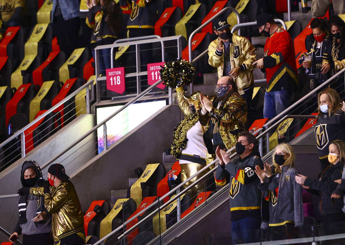 Fans celebrate after the Golden Knights defeated the St. Louis Blues in an NHL hockey game at T ...