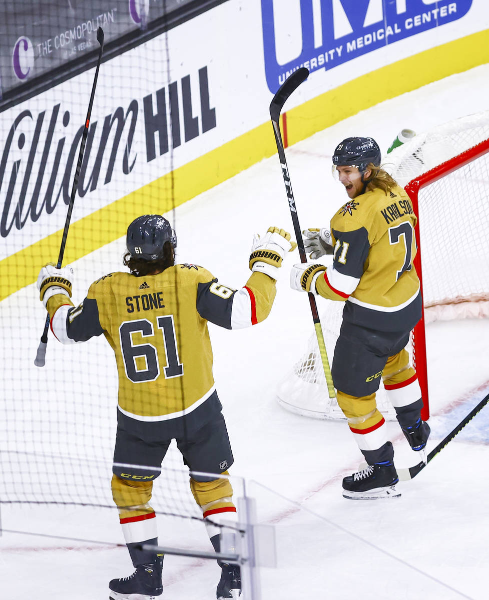 Golden Knights' William Karlsson (71) celebrates his goal after scoring against the St. Louis B ...