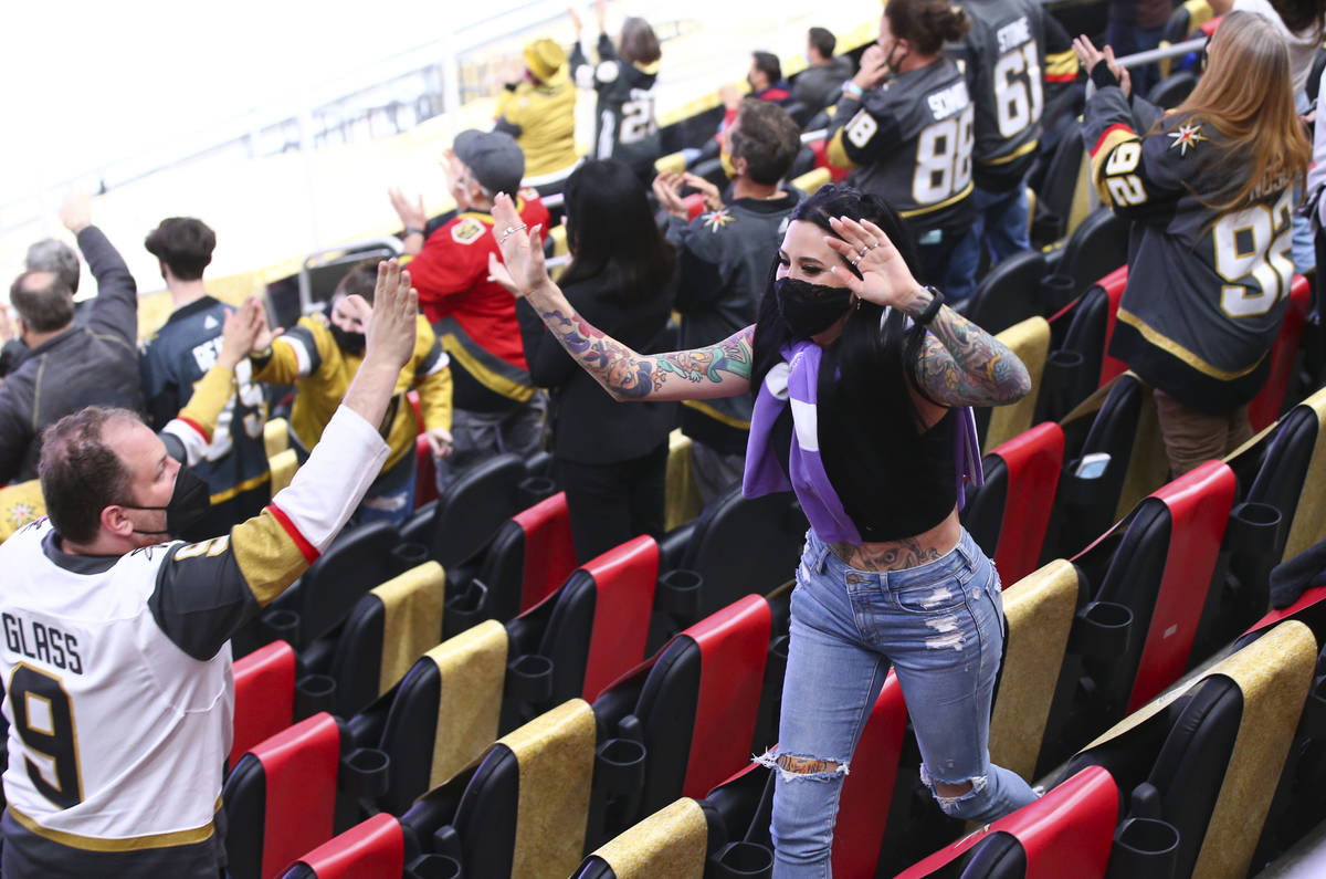 Fans celebrate after a goal by Golden Knights' Mark Stone, not pictured, against the St. Louis ...