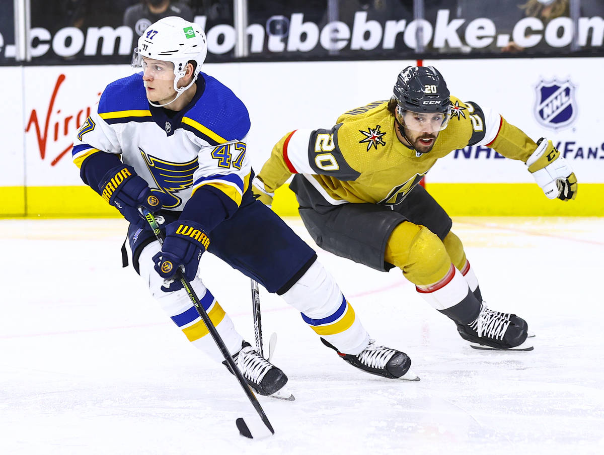 St. Louis Blues' Torey Krug (47) skates with the puck under pressure from Golden Knights' Chand ...