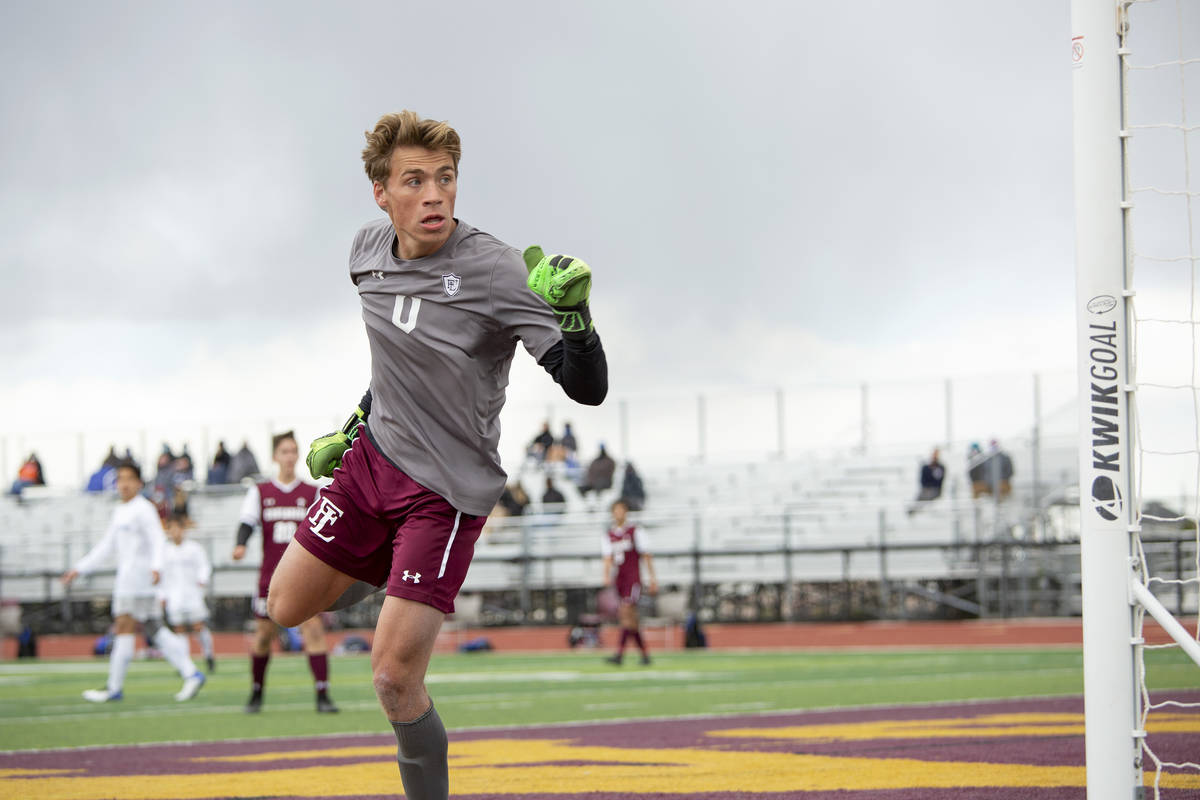 Faith Lutheran goalkeeper Landon Amick (0) looks to see that his block of a Bishop Gorman point ...