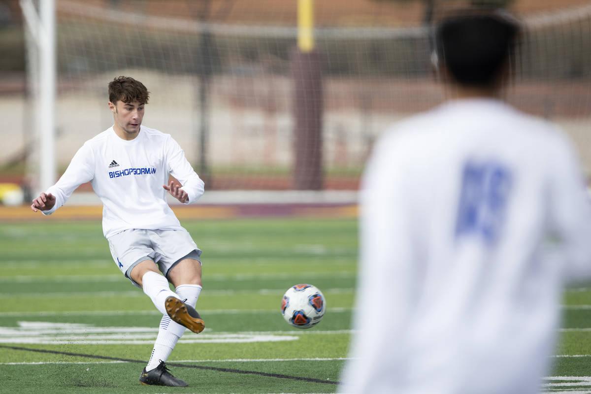 Bishop Gorman defender Keegan Brooks (4) passes the ball during a high school soccer game again ...