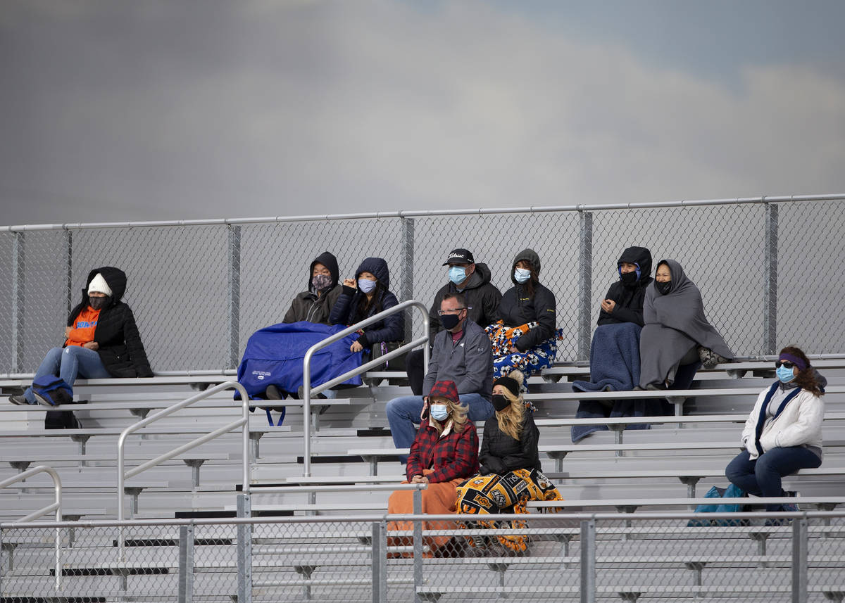 Bishop Gorman fans are dressed for cold weather while watching the boys varsity high school soc ...