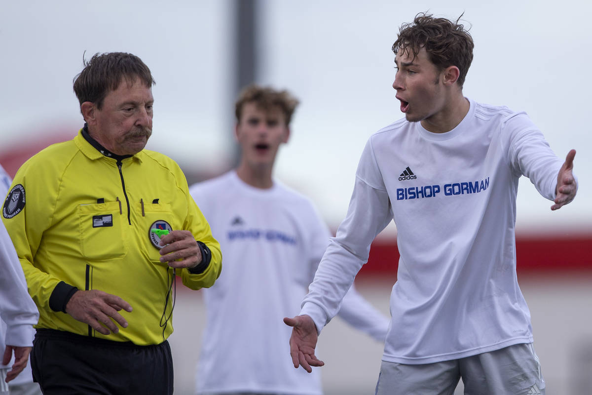 Bishop Gorman defender Keegan Brooks (4), right, argues with a referee about a call made during ...