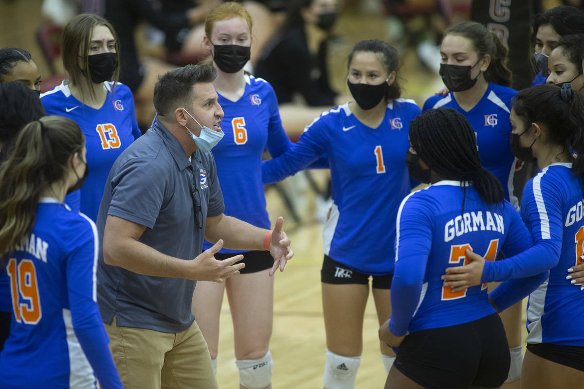 Bishop Gorman's coach Gregg Nunley speaks to his team in a time out during their girls high sch ...