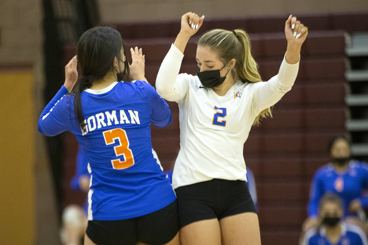 Bishop Gorman's Emma Glaser (3) and Morgan Mixer (2) celebrate after scoring a point during the ...