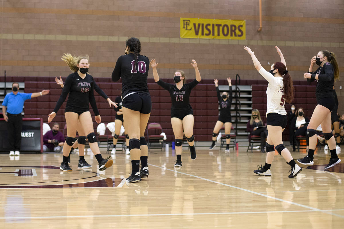 Faith Lutheran celebrates winning a match during their girls high school volleyball game agains ...