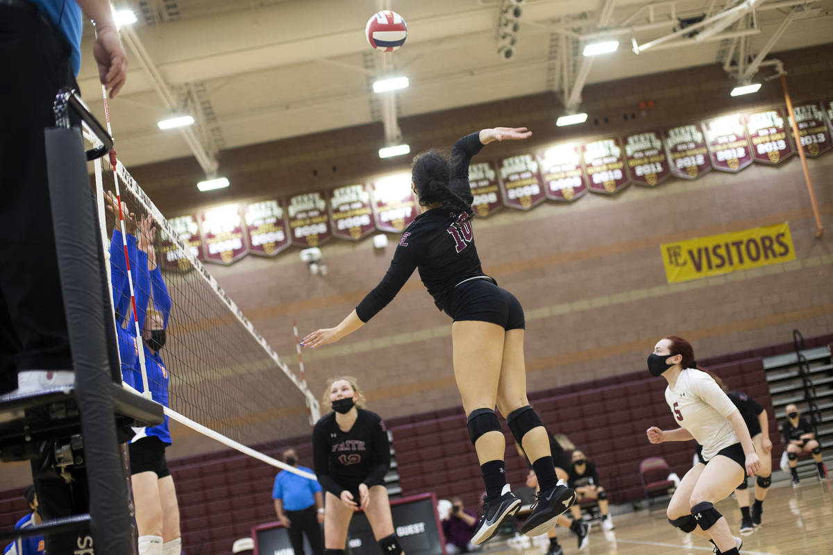 Faith Lutheran's Isabelle Guerrero (10) jumps to spike at Bishop Gorman during their girls high ...