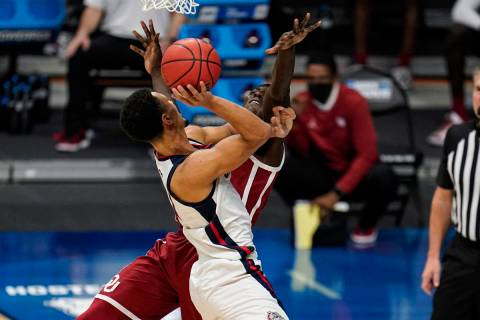 Gonzaga guard Jalen Suggs (1) charges into Oklahoma forward Kur Kuath (52) in the first half of ...