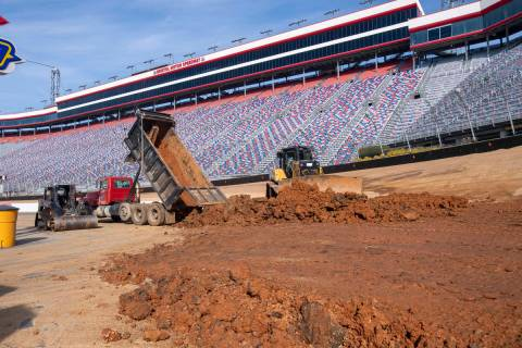 Workers turn Bristol Motor Speedway into a dirt track, in Bristol, Tenn., in this Thursday, Jan ...