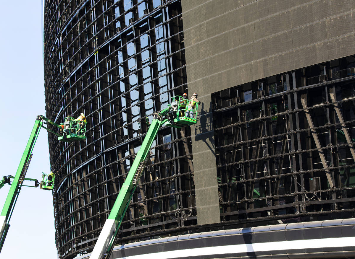 Workers removing video panels on Allegiant Stadium, on Wednesday, March 24, 2021, in Las Vegas. ...