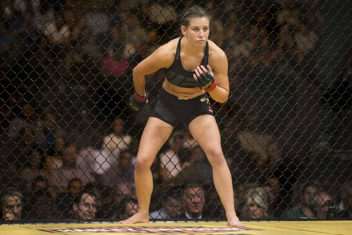 Miesha Tate gets ready to fight against Amanda Nunes in the women's bantamweight title bout dur ...