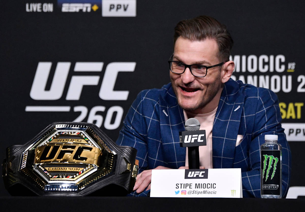 Stipe Miocic interacts with media during the UFC 260 press conference at UFC APEX on March 25, ...