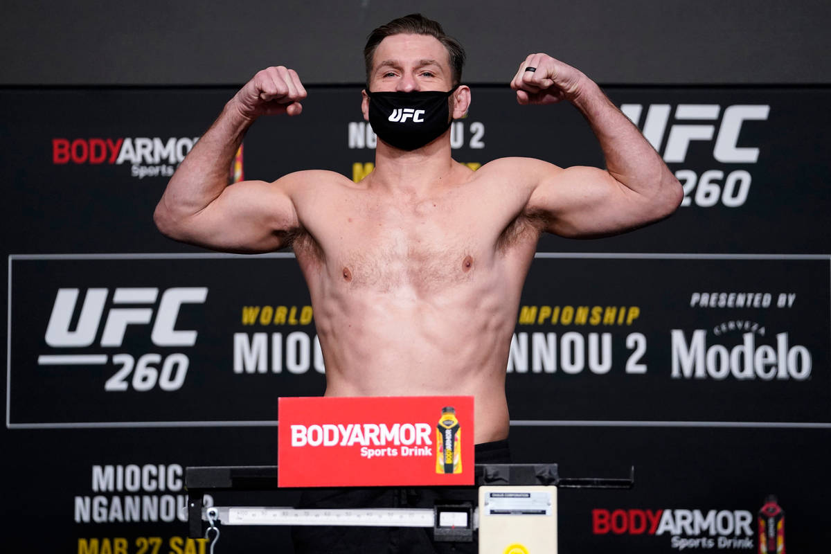 Stipe Miocic poses on the scale during the UFC 260 weigh-in at UFC APEX on March 26, 2021 in La ...