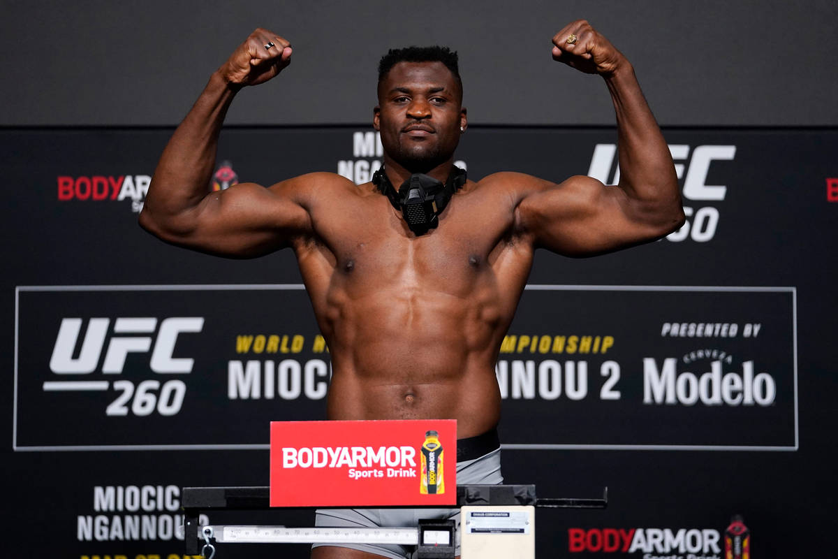 Francis Ngannou of Cameroon poses on the scale during the UFC 260 weigh-in at UFC APEX on March ...