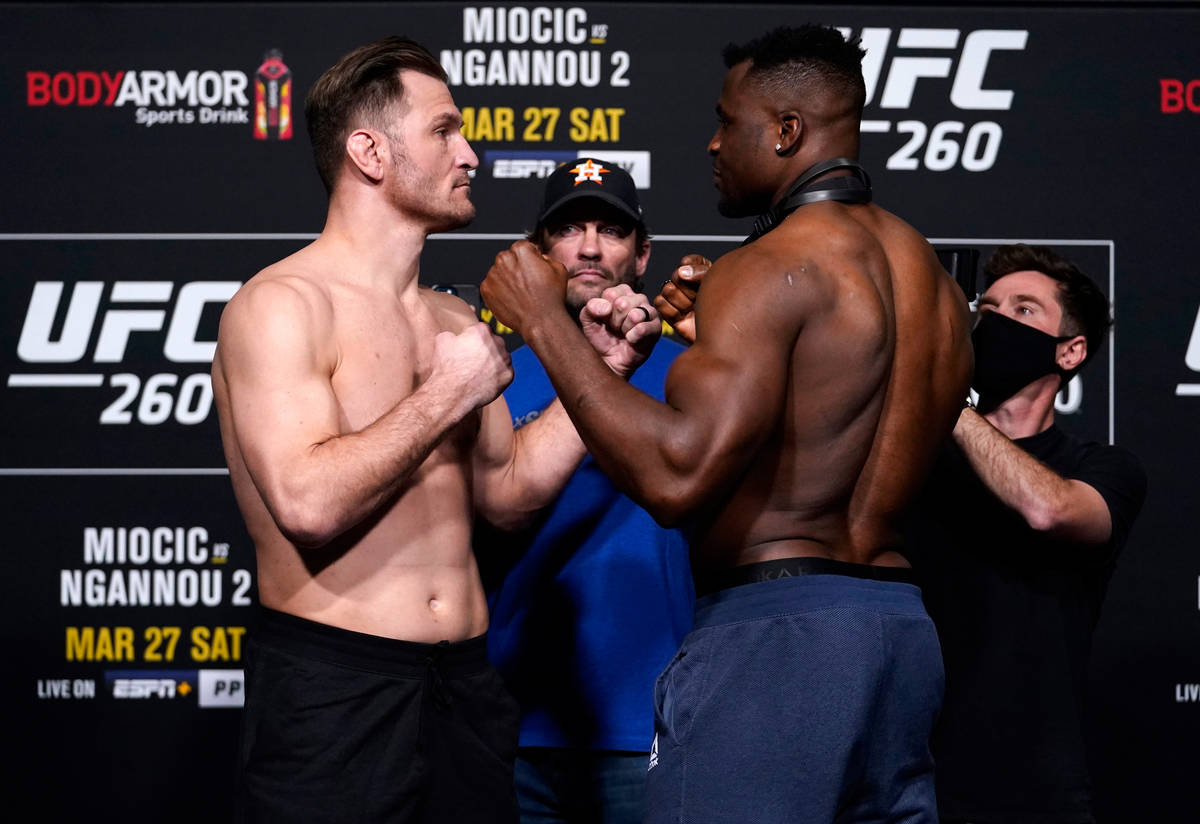 Opponents Stipe Miocic and Francis Ngannou of Cameroon face off during the UFC 260 weigh-in at ...