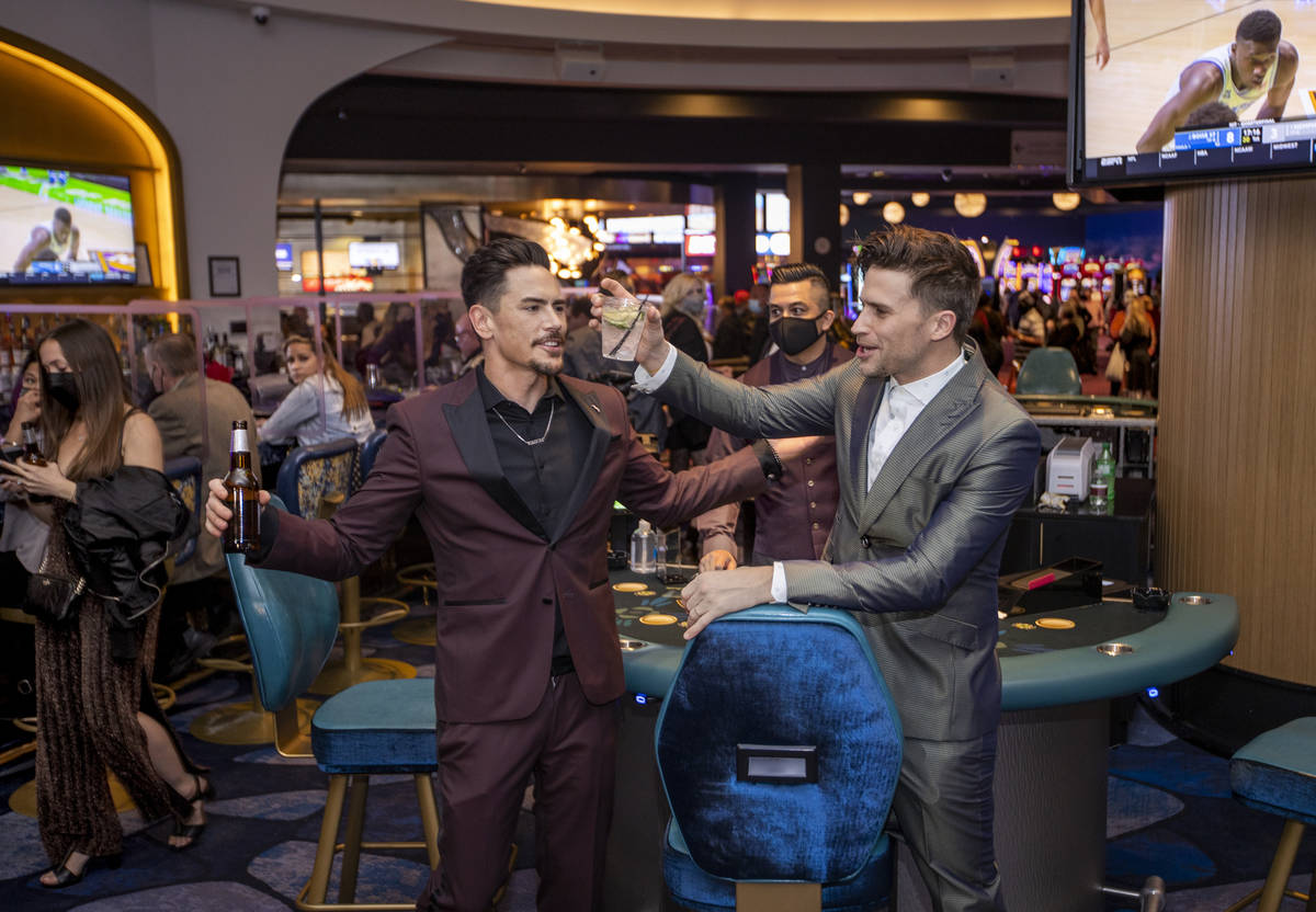 Tom Sandoval, left, and Tom Schwartz, both with Vanderpump Rules celebrate with a drink in the ...