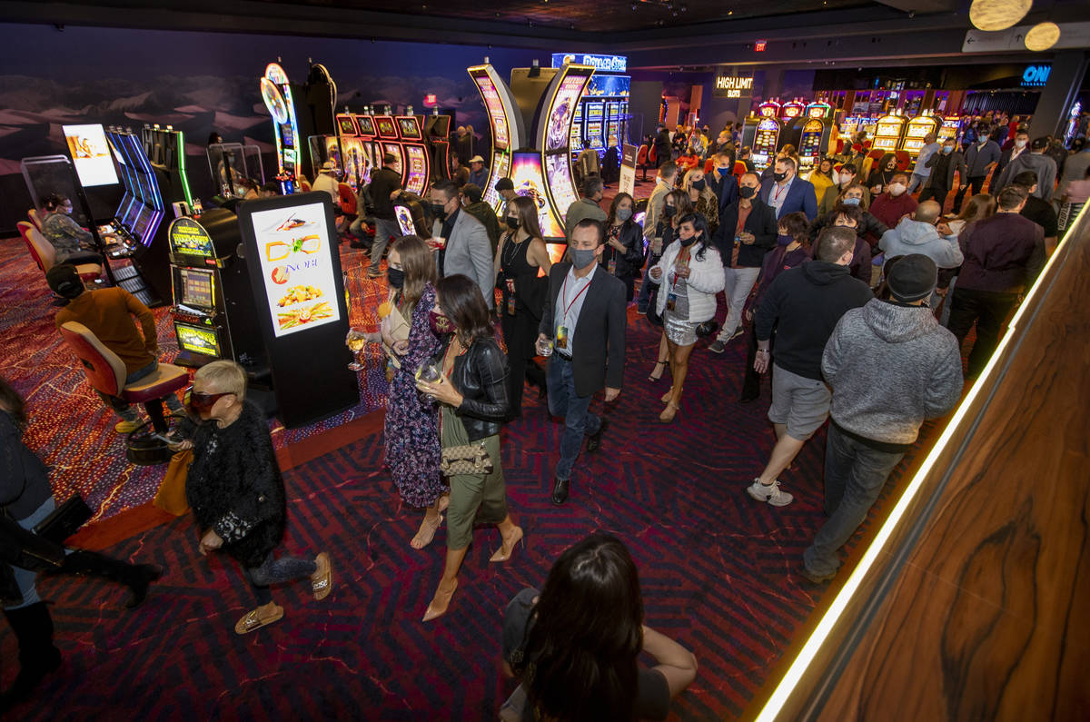 The crowd continues to get larger and flows about the casino floor during the Virgin Hotels Las ...