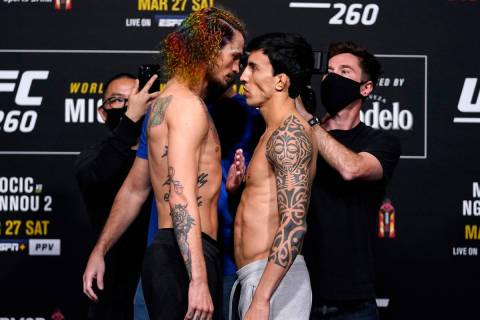 Opponents Sean O'Malley and Thomas Almeida of Brazil face off during the UFC 260 weigh-in at UF ...