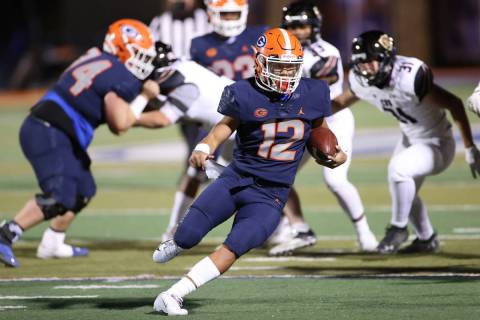 Bishop Gorman's Micah Alejado (12) runs the ball against Faith Lutheran during the second quart ...
