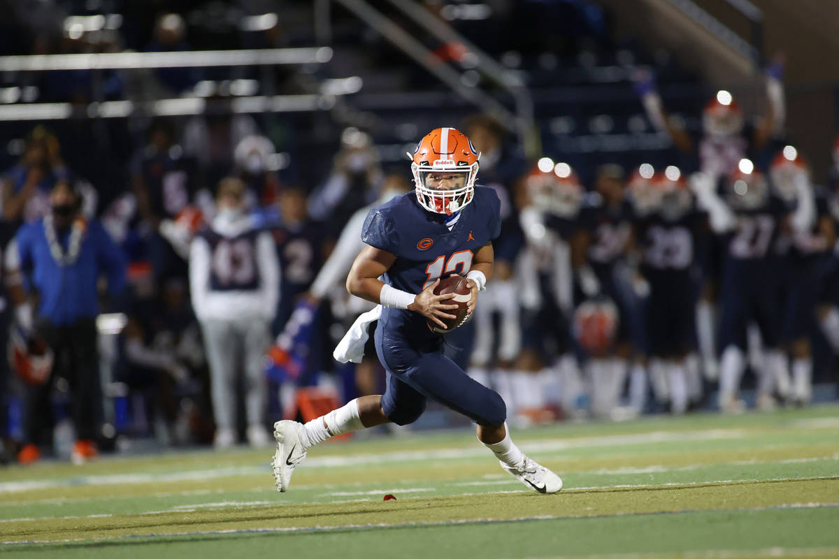Bishop Gorman's Micah Alejado (12) looks for an open pass against Faith Lutheran during the sec ...