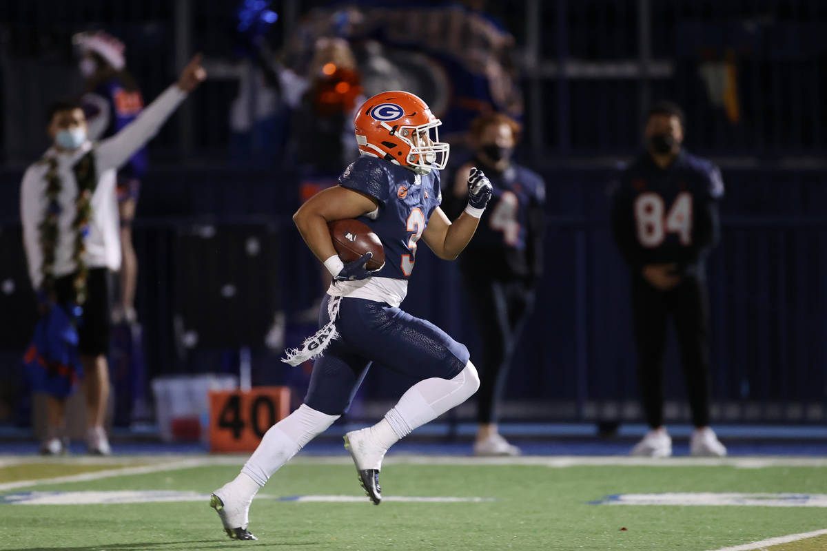 Bishop Gorman's Cam'ron Barfield (3) runs the ball for a touchdown in the first quester of a fo ...