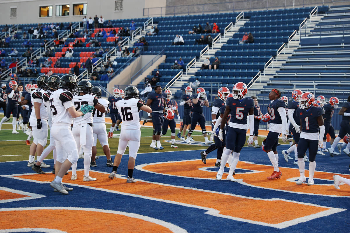 Players with Bishop Gorman and Faith Lutheran taunt each other before the start of their footba ...