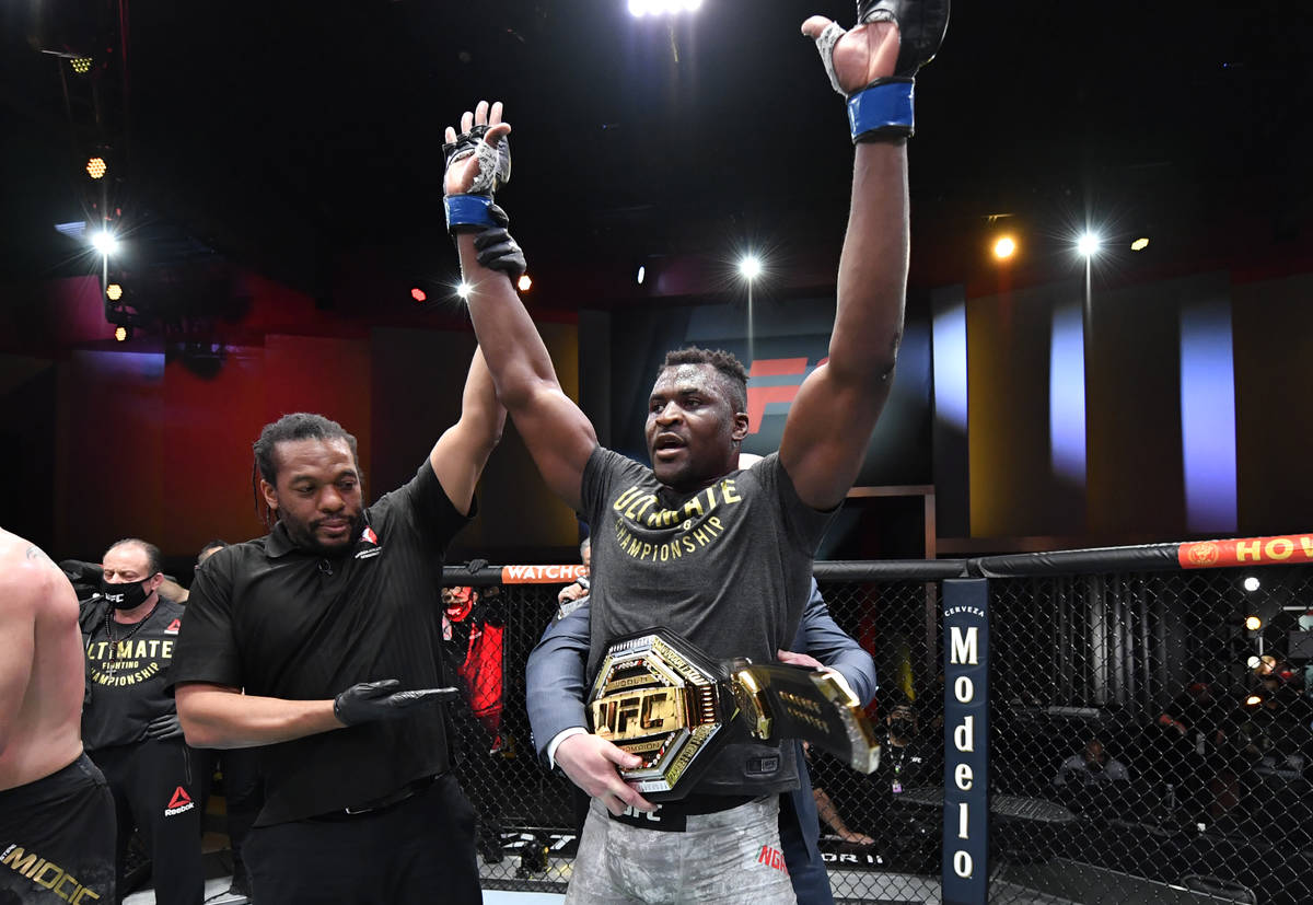 Francis Ngannou of Cameroon reacts after his victory over Stipe Miocic in their UFC heavyweight ...
