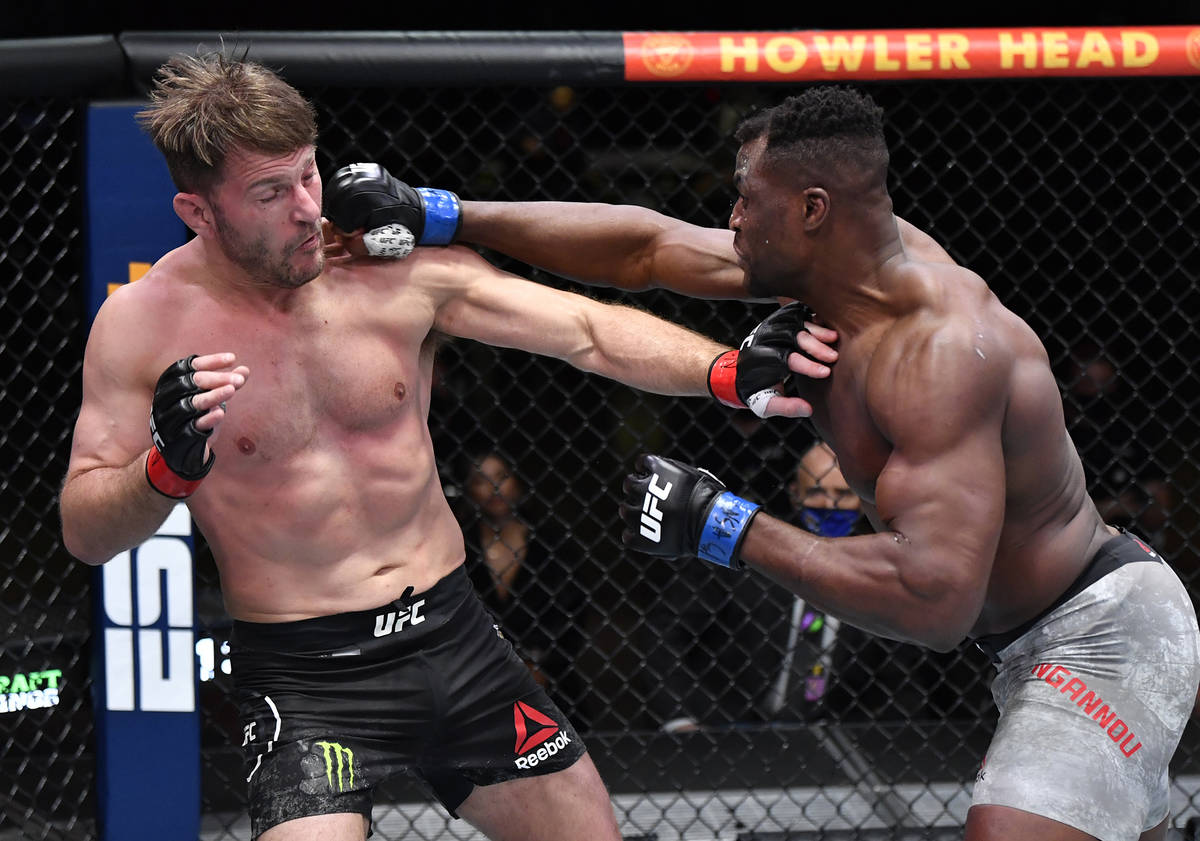 Francis Ngannou of Cameroon punches Stipe Miocic in their UFC heavyweight championship fight du ...